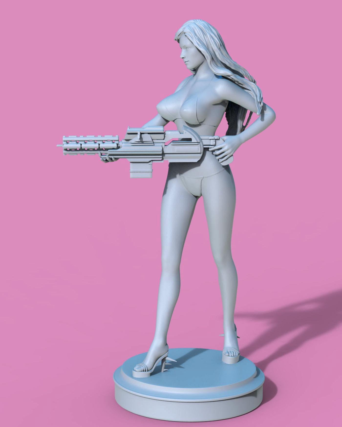 Sexy girl with the big gun