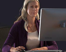 Blond female sitting behind a desk 3D