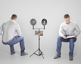 3D asset Seated cute young man in suit reading 180