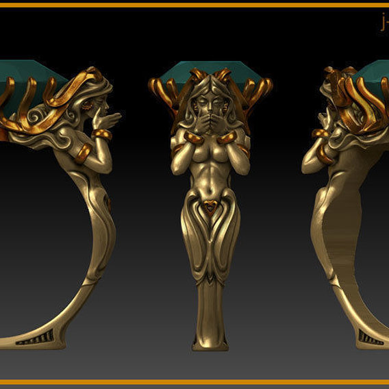 Fantasy ring with female sculpture.
