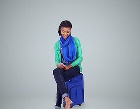 3D Woman Sitting on Blue Suitcase and Texting