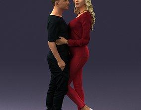 3D model Blonde in red hugs a man 0359
