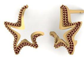 Model of starfish earrings with diamonds